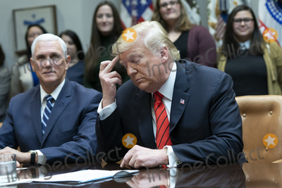 The Interns Photo - United States President Donald J Trump congratulates NASA astronauts Jessica Meir and Christina Koch from the White House in Washington DC after they conducted the first all-female spacewalk outside of the International Space Station on Friday October 18 2019  With Trump at left is United States Vice President Mike PenceCredit Chris Kleponis  Pool via CNPAdMedia