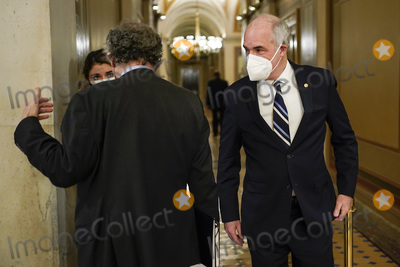Bob Casey Photo - US Senator Bob Casey (D-PA) walks past Senator Sherrod Brown (D-OH) during a break in the impeachment trial of former US President Donald Trump on charges of inciting the deadly attack on the US Capitol on Capitol Hill in Washington US February 10 2021 Credit Joshua Roberts - Pool via CNPAdMedia
