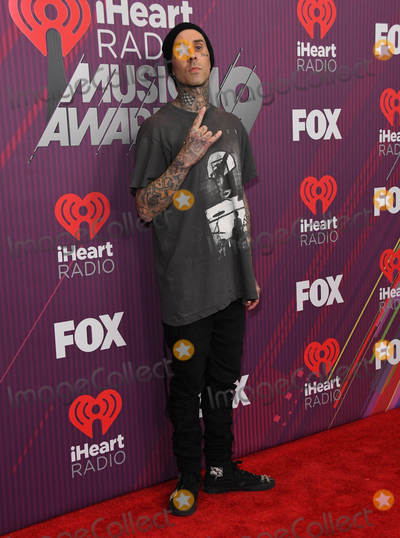 Travis Barker Photo - 14 March 2019 - Los Angeles California - Travis Barker 2019 iHeart Radio Music Awards - Press Room held at Microsoft Theater Photo Credit Birdie ThompsonAdMedia