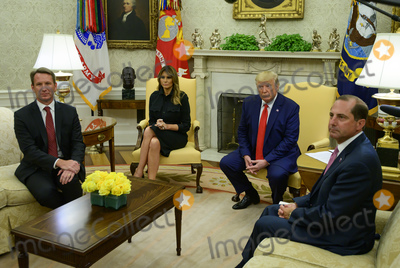 Alex Azar Photo - United States President Donald J Trump right center flanked by acting Commissioner of Food and Drug (FDA) Norman Sharpless left first lady Melania Trump and US Secretary of Health and Human Services (HHS) Alex Azar right announces a plan to ban all non-tobacco flavored vaping products from the market in the Oval Office of the White House in Washington DC on Wednesday September 11 2019  The President also took questions from reporters Photo Credit Ron SachsCNPAdMedia