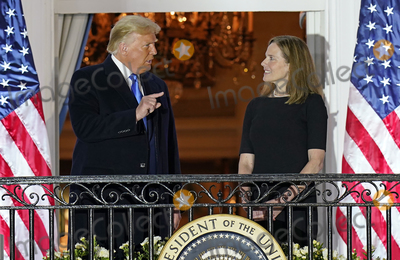 Supremes Photo - United States President Donald J Trump gestures towards Justice Amy Coney Barrett following the ceremony where she took the oath of office to be Associate Justice of the Supreme Court on the Blue Room Balcony of the White House in Washington DC US October 26 2020 Credit Chris Kleponis  Pool via CNPAdMedia