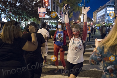 Vice President Joe Biden Photo - Into the night people celebrate and dance in the streets near the White House in the hours after Democratic presidential candidate and former Vice President Joe Biden was elected president in Washington DC Saturday November 7 2020 Credit Rod Lamkey  CNPAdMedia