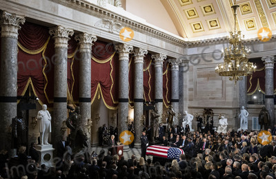 Elijah Cummings Photo - United States Senate Majority Leader Mitch McConnell (Republican of Kentucky) left speaks near the American flag-draped casket of United States Representative Elijah Cummings (Democrat of Maryland) during a memorial service in National Statuary Hall at the US Capitol in Washington DC US on Thursday Oct 24 2019 Cummings a key figure in Democrats impeachment inquiry and a fierce critic of United States President Donald J Trump died at the age of 68 on October 17 due to complications concerning long-standing health challengesCredit Al Drago  Pool via CNPAdMedia