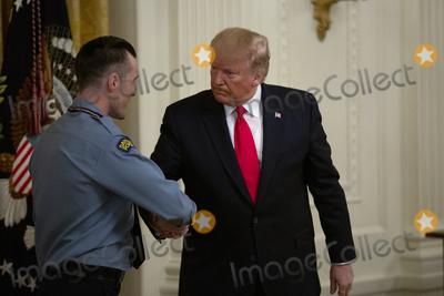 Police Officer Photo - United States President Donald J Trump presents the Medal of Valor to Dayton Police Officer David Denlinger during an East Room ceremony at the White House in Washington DC US on September 9 2019  Credit Stefani Reynolds  CNPAdMedia