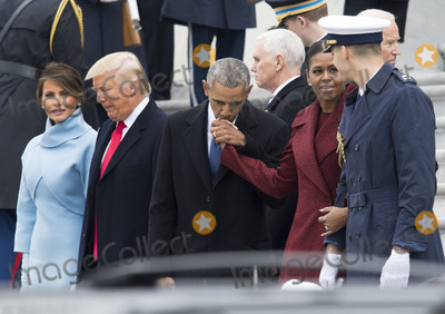 Jill Biden Photo - Former President Barack Obama and former First Lady Michelle Obama hug Vice President Joe Biden and his wife Jill Biden following the inauguration of President Donald Trump on Capitol Hill in Washington DC on January 20 2017 President-Elect Donald Trump was sworn-in as the 45th President Photo Credit Kevin DietschCNPAdMedia