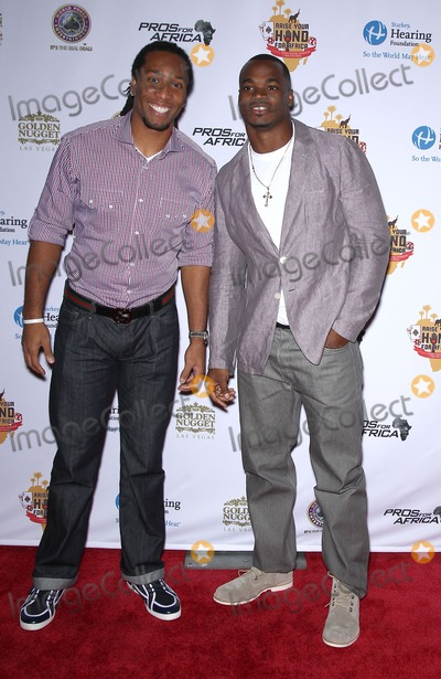 Adrian Peterson Photo - 19 February 2011 - Las Vegas Nevada - Larry Fitzgerald Adrian Peterson Celebrities Poker Pros and Football Stars Raise Their Hand For Africa Texas Holdem Charity Tournament at the Golden Nugget Hotel and Casino Photo MJTAdMedia