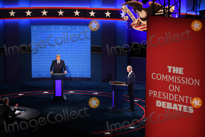 Presidential Campaign Photo - President Donald Trump and Democratic presidential nominee Joe Biden with moderator Chris Wallace prepare to face off in the first of three scheduled 90 minute presidential debates in Cleveland Ohio on Tuesday September 29 2020 Credit Kevin Dietsch  Pool via CNPAdMedia