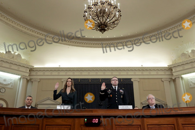 Alexander Vindman Photo - WASHINGTON DC - NOVEMBER 19 Lt Col Alexander Vindman (R) National Security Council Director for European Affairs and Jennifer Williams (L) adviser to Vice President Mike Pence for European and Russian affairs are sworn in prior to testifying before the House Intelligence Committee in the Longworth House Office Building on Capitol Hill November 19 2019 in Washington DC The committee heard testimony during the third day of open hearings in the impeachment inquiry against US President Donald Trump who House Democrats say withheld US military aid for Ukraine in exchange for Ukrainian investigations of his political rivals Credit Chip Somodevilla  Pool via CNPAdMedia