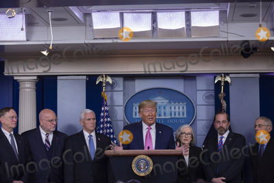 Alex Azar Photo - United States President Donald J Trump delivers remarks during a news conference in the James S Brady Briefing Room of the White House in Washington DC US on Wednesday February 26 2020  Trump joined by members of the Coronavirus Task Force including US Vice President Mike Pence third left attempted to lessen concerns over the Coronavirus after health officials told lawmakers that it is seemingly inevitable that the disease will spread in the United StatesCredit Stefani Reynolds  CNPAdMedia