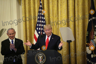 Benjamin Netanyahu Photo - United States President Donald J Trump speaks as Israels Prime Minister Benjamin Netanyahu applauds during a meeting in the East Room of the White House in Washington DCon Tuesday January 28 2020 Credit Joshua Lott  CNPAdMedia