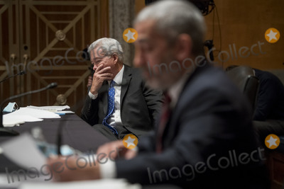 The Faces Photo - Former Assistant Director for Intelligence Federal Bureau of Investigation Kevin R Brock left and Investigative Journalist  Author Lee Smith right appear before a Senate Committee on Homeland Security and Governmental Affairs hearing to examine Congressional oversight in the face of Executive Branch and media suppression focusing on the case study of Crossfire Hurricane in the Dirksen Senate Office Building in Washington DC Thursday December 3 2020 Credit Rod Lamkey  CNPAdMedia