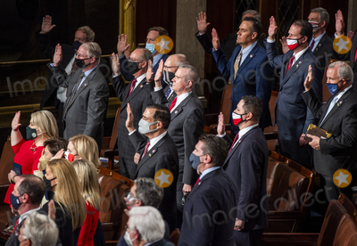 House Speaker Nancy Pelosi Photo - Republican members of the House raise their hands to be sworn in by House Speaker Nancy Pelosi (D-Calif) on the opening day of the 117th Congress at the US Capitol in Washington DC on January 03 2021 Credit Bill OLeary  Pool via CNPAdMedia
