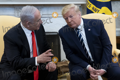 Benjamin Netanyahu Photo - United States President Donald J Trump (R) listens to Prime Minister Benjamin Netanyahu of Israel (L) during their meeting in Oval Office of the White House in Washington DC USA 27 January 2020 President Trump is expected to unveil a Middle East peace plan during the visit of Prime Minister Netanyahu 28 JanuaryCredit Michael Reynolds  Pool via CNPAdMedia
