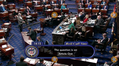 The Used Photo - In this image from United States Senate television the US Senate votes on the single Article of Impeachment against former US President Donald J Trump during Day 5 of the second impeachment trial of the former president in the US Senate in the US Capitol in Washington DC on Saturday February 13 2021Mandatory Credit US Senate TV via CNPAdMedia