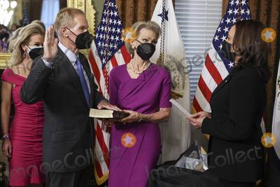 The National Photo - US Vice President Kamala Harris right swears in Bill Nelson left former Democratic Senator from Florida and administrator of the National Aeronautics and Space Administration (NASA) alongside his wife Grace Nelson holding the bible in the Eisenhower Executive Office Building in Washington DC US on May 3 2021 The Senate confirmed Nelson on April 29 and had served as the chairman and ranking member of the Senate subcommittee that oversees NASA Credit Oliver Contreras  Pool via CNPAdMedia