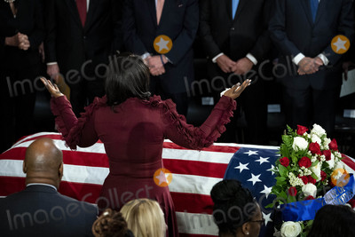 Elijah Cummings Photo - Maya Rockeymoore widow of late United States Representative Elijah Cummings (Democrat of Maryland) raises her arms over the casket of Cummings during a memorial service in National Statuary Hall at the US Capitol in Washington DC US on Thursday Oct 24 2019 Cummings a key figure in Democrats impeachment inquiry and a fierce critic of US President Donald J Trump died at the age of 68 on October 17 due to complications concerning long-standing health challenges Credit Al Drago  Pool via CNPAdMedia