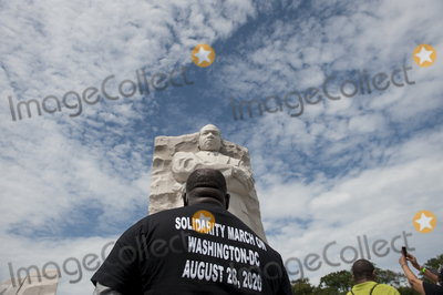 Martin Luther King Photo - A man stands under the sculpture of Martin Luther King Jr at the Martin Luther King Jr Memorial following the Get Your Knee Off Our Necks March on Washington at the Lincoln Memorial in Washington DC Friday August 28 2020 Credit Rod Lamkey  CNPAdMedia