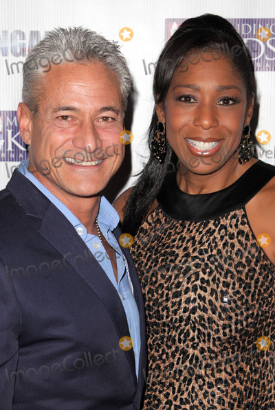 Christopher Atkins Photo - 09 November 2013 - Santa Monica - Greg LouganisDawnn LewisSANTA MONICA CA - NOVEMBER 09 Kale Flowers Mia Coblentz and Christopher AtkinsMichael BezjianPeople  Mending Kids Internationals Wings Around The World African Safari Gala - Red Carpet at Santa Monica Airport Photo Credit Kevan BrooksAdMedia