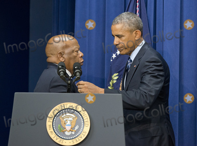 Barack Obama Photo - United States Representative John Lewis (Democrat of Georgia)l left welcomes US President Barack Obama to the podium to make remarks at a session hosted by the White House Office of Public Engagement on strengthening and protecting the right to vote at the White House in Washington DC on Thursday August 6 2015 The event was attended by civil rights leaders faith leaders voting rights activists and state and local officialsCredit Ron Sachs  Pool via CNPAdMedia