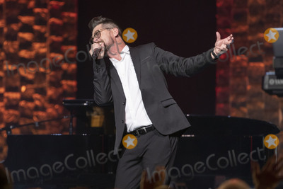 Jason Crabb Photo - 30 April 2019 - Nashville Tennessee - Jason Crabb performs on stage at 35 Years of Friends Celebrating the Music of Michael W Smith held at Bridgestone Arena Photo Credit Frederick BreedonAdMedia