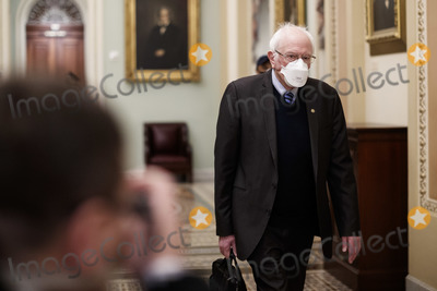 Bernie Sanders Photo - Senator Bernie Sanders an Independent from Vermont wears a protective mask while walking through the US Capitol in Washington DC US on Saturday Feb 13 2021 The Senate approved 55-45 a request to consider calling witnesses in the second impeachment trial of Donald Trump a move that may extend the trial that was expected to end within hours Credit Ting Shen - Pool via CNPAdMedia