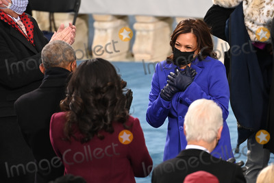 First Lady Michelle Obama Photo - US Vice President-elect Kamala Harris (R) meets former US First Lady Michelle Obama and former US President Barack Obama before US President-elect Joe Biden is sworn in as the 46th US President on January 20 2021 at the US Capitol in Washington DC - Biden a 78-year-old former vice president and longtime senator takes the oath of office at noon (1700 GMT) on the US Capitols western front the very spot where pro-Trump rioters clashed with police two weeks ago before storming Congress in a deadly insurrection (Photo by Saul LOEB  POOL  AFP)AdMedia
