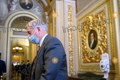 Lindsey Graham Photo - Senator Lindsey Graham R-SC  walks across the  Senate Reception Room to meet with Trump defense team in the US Capitol at the conclusion of day two in the second impeachment trial of former US president Donald Trump in Washington DC on February 11 2021 POOLAFP PHOTOCredit Mandel Ngan - Pool via CNPAdMedia