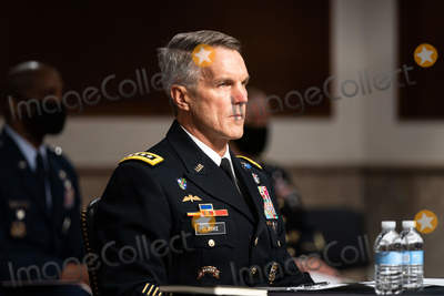 The Unit Photo - General Richard D Clarke USA Commander United States Special Operations Command listens during a hearing on the United States Special Operations Command and United States Cyber Command with the Senate Armed Services Committee on Capitol Hill in Washington DC on March 25th 2021Credit Anna Moneymaker  Pool via CNPAdMedia