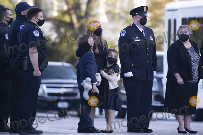 The Used Photo - Family members of US Capitol Police Officer William Evans wife Shannon Terranova (C) their nine-year-old son Logan (C-L) and seven-year-old daughter Abigail (C-R) and his mother Janice Evans watch the casket of Officer Evans being carried by a joint service honor guard down the East Front steps of the US Capitol and placed into a hearse after lying in honor in the Capitol Rotunda in Washington DC USA 13 April 2021 A Tribute and Lying in Honor Ceremony took place for Officer Evans who was killed and another officer injured in the line of duty when a suspect rammed a vehicle at the North entrance of the Capitol 02 AprilCredit Michael Reynolds  Pool via CNPAdMedia