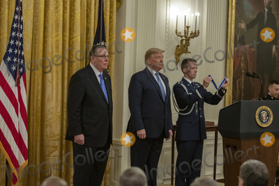 Keane Photo - United States President Donald J Trump center listens to the citation as he presents the Presidential Medal of Freedom to US Army General John M Jack Keane (retired) left during a ceremony in the East Room of the White House in Washington DC on Tuesday March 10 2020  Keane is a former Vice Chief of Staff of the US Army and is a Fox News national security analystCredit Ron Sachs  CNPAdMedia
