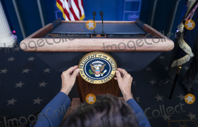 Seal Photo - Communications staff installs the presidential seal on the lectern prior to President Donald Trump delivering remarks on the stock marked and the Dow reaching 30000 for the first time in history at the White House in Washington DC on Tuesday November 24 2020Credit Kevin Dietsch  Pool via CNPAdMedia