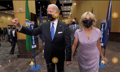 Joe Biden Photo - In this image from the Democratic National Convention video feed former United States Vice President Joe Biden the 2020 Democratic Party nominee for President of the US and his wife Dr Jill Biden walk out after he delivered his acceptance speech on the last night of the convention on Thursday August 20 2020Credit Democratic National Convention via CNPAdMedia