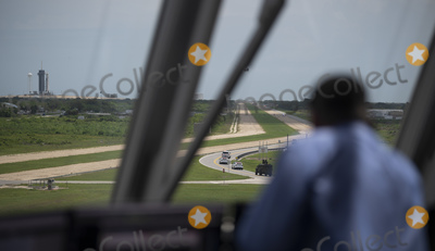 The Interns Photo - In this photo released by the National Aeronautics and Space Administration (NASA) Tthe convoy carrying NASA astronauts Robert Behnken and Douglas Hurley is seen through the windows of firing room four as it makes its way to Launch Complex 39A ahead of the launch of NASAs SpaceX Demo-2 mission Saturday May 30 2020 in the Launch Control Center at NASAs Kennedy Space Center in Florida NASAs SpaceX Demo-2 mission is the first launch with astronauts of the SpaceX Crew Dragon spacecraft and Falcon 9 rocket to the International Space Station as part of the agencys Commercial Crew Program The test flight serves as an end-to-end demonstration of SpaceXs crew transportation system Behnken and Hurley are scheduled to launch at 322 pm EDT on Saturday May 30 from Launch Complex 39A at the Kennedy Space Center A new era of human spaceflight is set to begin as American astronauts once again launch on an American rocket from American soil to low-Earth orbit for the first time since the conclusion of the Space Shuttle Program in 2011 Mandatory Credit Joel Kowsky  NASA via CNPAdMedia