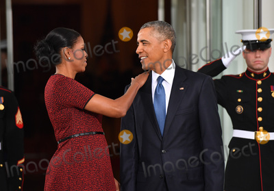 President Barack Obama Photo - President Barack Obama (R) and Michelle Obama share a moment as they wait for President-elect Donald Trump and wife Melania at the White House before the inauguration on January 20 2017 in Washington DC  Trump becomes the 45th President of the United States Photo Credit Kevin DietschCNPAdMedia