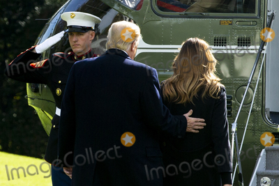 Alabama Photo - US President Donald J Trump (C) and First Lady Melania Trump (R) board Marine One beside a US Marine (L) on the South Lawn of the White House in Washington DC USA 09 November 2019 The President and First Lady will attend a National Collegiate Athletic Association (NCAA) football game between Alabama and Louisiana State University in Tuscaloosa Alabama then they will stay in New York City through Veterans DayCredit Michael Reynolds  Pool via CNPAdMedia