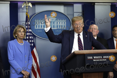 Devo Photo - United States President Donald J Trump speaks between US Secretary of Education Betsy DeVos left and US Secretary of Agriculture Sonny Perdue right center and Panera Bread CEO Niren Chaudhary right during a press briefing on the Coronavirus COVID-19 pandemic with members of the Coronavirus Task Force at the White House in Washington DC on March 27 2020  Credit Yuri Gripas  Pool via CNPAdMedia