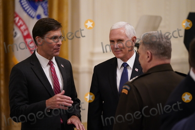 The Ceremonies Photo - United States Secretary of Defense Dr Mark T Esper US Vice President Mike Pence and US Army General Mark A Milley Chairman of the Joint Chiefs of Staff attend the ceremony where US President Donald J Trump presented the Medal of Honor to Sergeant Major Thomas Payne US Army in the East Room of the White House in Washington DC on September 11 2020 Payne is the 1st living Delta Force member to receive the Medal of Honor Credit Chris Kleponis  Pool via CNPAdMedia