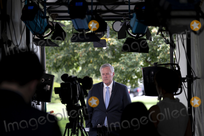 House Speaker Nancy Pelosi Photo - Mark Meadows White House Chief of Staff speaks during a television interview outside the White House in Washington DC US on Friday August 28 2020  Meadows stated that the White House has offered House Speaker Nancy Pelosi a 13 trillion stimulus package that President Donald Trump would sign today and stated that the talks remain stalled due to her reluctance to compromise Credit Stefani Reynolds  Pool via CNPAdMedia