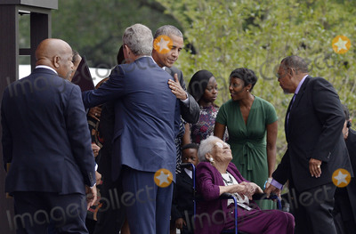 Barack Obama Photo - United States President Barack Obama hugs former US President George W Bush as US Representative John Lewis (Democrat of Georgia) left looks on during the opening ceremony of the Smithsonian National Museum of African American History and Culture on September 24 2016 in Washington DC The museum is opening thirteen years after Congress and President George W Bush authorized its construction Credit Olivier Douliery  Pool via CNPAdMedia