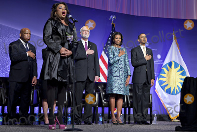 Barack Obama Photo - United States President Barack Obama and First Lady Michelle Obama listen to the National Anthem sung by Denyce Graves at the groundbreaking ceremony of the Smithsonian National Museum of African American History and Culture in Washington DC on Wednesday February 22 2012 The museum is scheduled to open in 2015 and will be the only national museum devoted exclusively to the documentation of African American life art history and culture From left to right US Representative John Lewis (Democrat of Georgia) Denyce Graves Wayne Clough Secretary Smithsonian Institution Mrs Obama and President ObamaCredit Andrew Harrer  Pool via CNPAdMedia