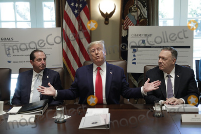 Alex Azar Photo - United States President Donald J Trump center speaks during a Cabinet Meeting at the White House in Washington DC on October 21 2019 Pictured at left is US Secretary of Health and Human Services (HHS) Alex Azar and at right is US Secretary of State Mike Pompeo Photo Credit Yuri GripasCNPAdMedia