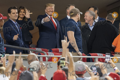 TI Photo - United States President Donald J Trump and First lady Melania Trump attend game five of the World Series at Nationals Park in Washington DC on October 27 2019 The Washington Nationals and Houston Astros are tied at two games going into tonights game Pictured attending with the president include United States Representative Matt Gaetz (Republican of Florida) and United States Representative Mark Meadows (Republican of North Carolina)Credit Chris Kleponis  Pool via CNPAdMedia