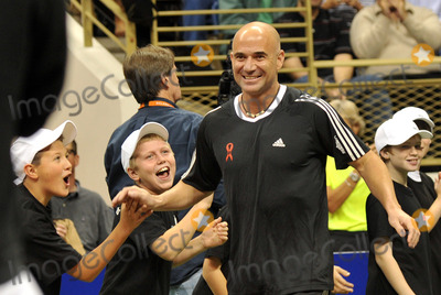 Andre Agassi Photo - 16 October 2012 - Pittsburgh PA - Tennis star ANDRE AGASSI participated with TEAM BILLIE JEAN at the Mylan WTT Smash Hits World Team Tennis Match held at the Petersen Events Center The 20th anniversary edition of Mylan WTTSmash Hits presented by GEICO was one for the record books with the event posting a record 1 million for the Elton John AIDS Foundation with a portion of those proceeds benefitting the Pittsburgh AIDS Task Force Theevent hosted annually by Sir Elton John and Billie Jean King has now raised more the 115 million to support HIV and AIDS prevention and awareness programs since the first Smash Hits was held in Los Angeles in 1993  Photo Credit Jason L NelsonAdMedia