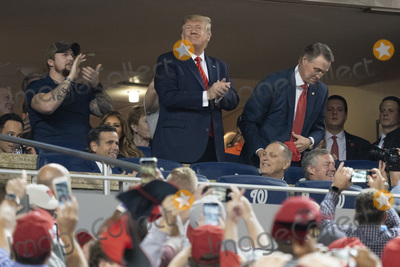 TI Photo - United States President Donald J Trump acknowledges the crowd during a moment to salute the military during game five of the World Series at Nationals Park in Washington DC on October 27 2019  The Washington Nationals and Houston Astros are tied at two games going into tonights game Those pictured with the president include United States Representative John Ratcliffe (Republican of Texas) United States Representative Andy Biggs (Republican of Arizona) and United States Representative Mark Meadows (Republican of North Carolina) Credit Chris Kleponis  Pool via CNPAdMedia