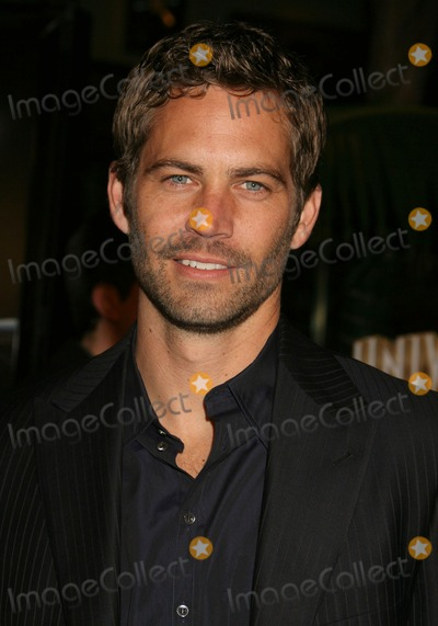 Paul Walker Photo - 30 November 2013 - Santa Clarita California - Paul Walker died at the age of 40 in a car accident while attending a charity event for his organization Reach Out Worldwide The accident occurred in Santa Clarita when Walkers Porsche lost control and crashed into a tree The car burst into flames and exploded File Photo 12 March 2009 - Universal City CA - Paul Walker Fast  Furious Los Angeles Premiere at the Universal City Walk Gibson Amphitheatre Photo Credit Michael JadeAdMedia
