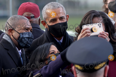 Barack Obama Photo - Former US President Barack Obama and wife Michelle Obama arrive before the inauguration of Joe Biden as the 46th President of the United States on the West Front of the US Capitol in Washington US January 20 2021 REUTERSJonathan ErnstPoolAdMedia