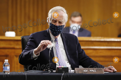 Angus King Photo - United States Senator Angus King Jr (Independent of Maine) wipes his microphone as he arrives for a US Senate Intelligence Committee nomination hearing for US Representative John Ratcliffe (Republican of Texas) on Capitol Hill in Washington Tuesday May 5 2020 The panel is considering Ratcliffes nomination for director of national intelligence Credit Andrew Harnik  Pool via CNPAdMedia