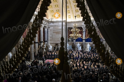 American Flag Photo - The American flag-draped casket of United States Representative Elijah Cummings (Democrat of Maryland) sits during a memorial service in National Statuary Hall at the US Capitol in Washington DC US on Thursday Oct 24 2019 Cummings a key figure in Democrats impeachment inquiry and a fierce critic of US President Donald J Trump died at the age of 68 on October 17 due to complications concerning long-standing health challenges Credit Al Drago  Pool via CNPAdMedia