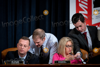 Hurts Photo - United States Representative Doug Collins (Republican of Georgia) Ranking Member US House Judiciary Committee left confers with US Representative Jim Jordan (Republican of Ohio) left center and Ashley Hurt Callen Republican staff counsel right center confers with an aide during a US House Judiciary Committee hearing considering articles of impeachment against US President Donald J Trump on Capitol Hill in Washington DC on December 9 2019 Credit Erin Schaff  Pool via CNPAdMedia