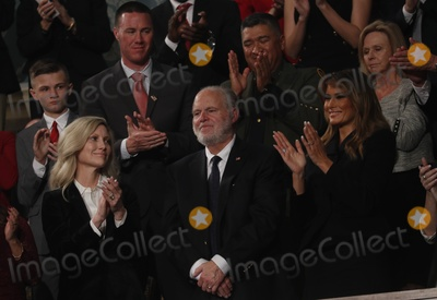 Rush Photo - Radio personality Rush Limbaugh is honored by US President Donald Trump with a Presidential Medal of Freedom as he stands with first lady Melania Trump during the State of the Union address to a joint session of the US Congress in the House Chamber of the US Capitol in Washington US February 4 2020 Credit Leah Millis  Pool via CNPAdMedia